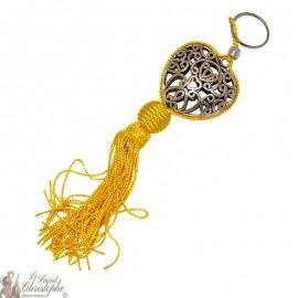 Llavero corazón arabesco amarillo plateado pompón